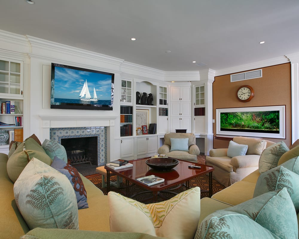 Westchester County home in a traditional style with integrated flat panel TVs