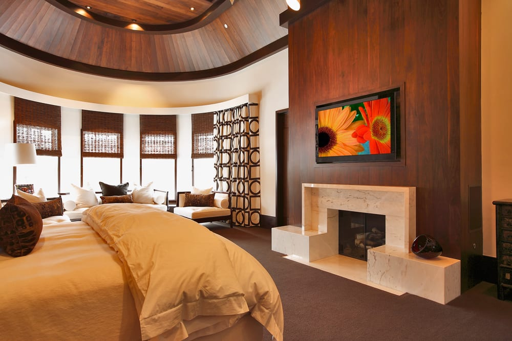 Bedroom with custom wood panel finish and integrated flat panel TV