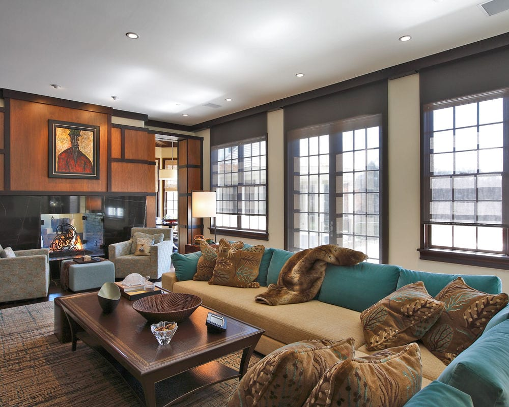 Elegant family room with automated window shades and recessed lighting