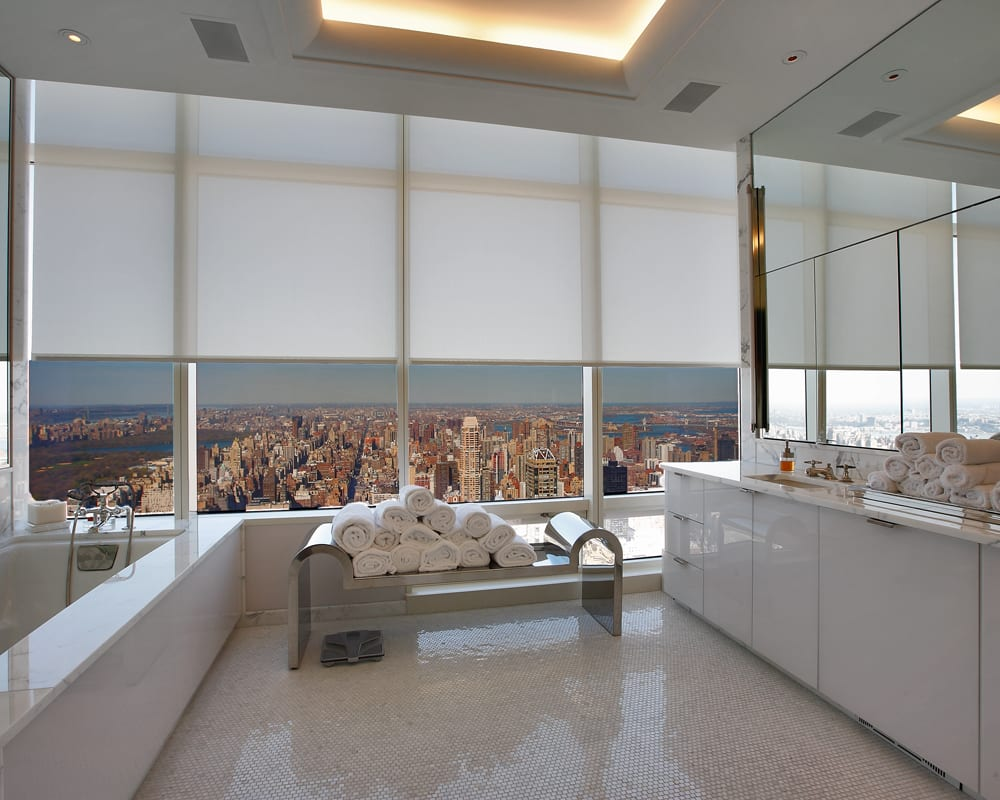 Bathroom with floor-to-ceiling windows with motorized shades in Manhattan